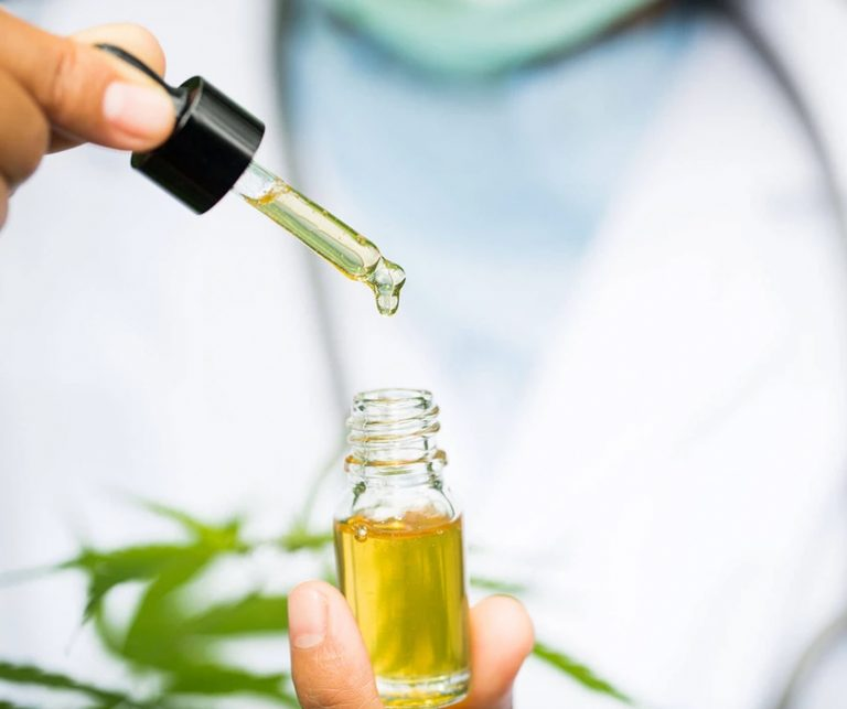 CBD oil being used in a tincture dropper