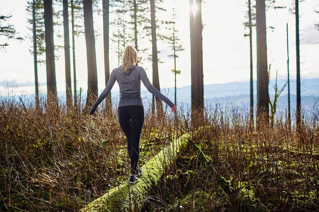 girl walking through forest how does the endocannabinoid system work