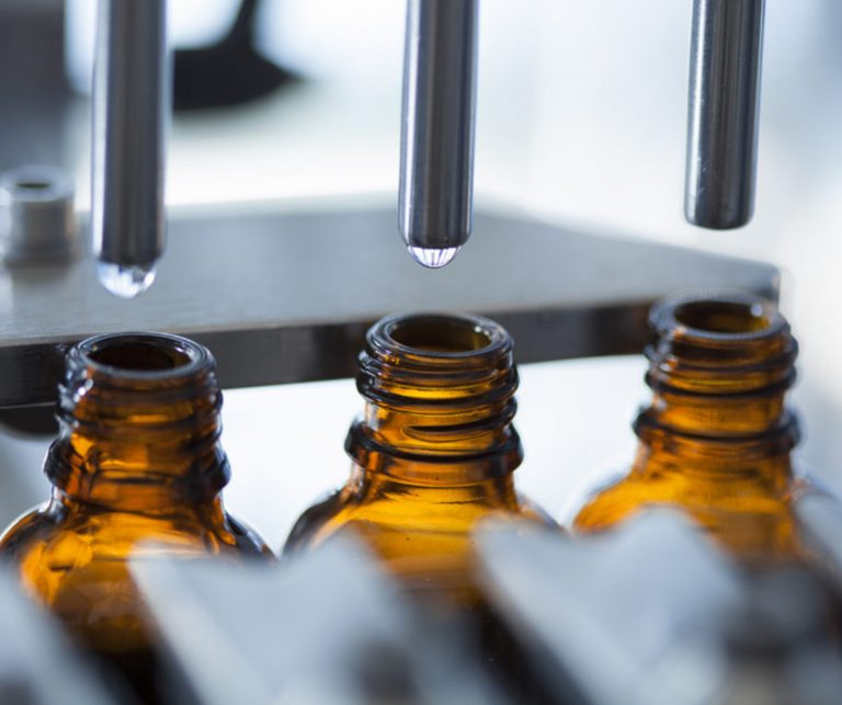 Private Label CBD tincture bottles being filled