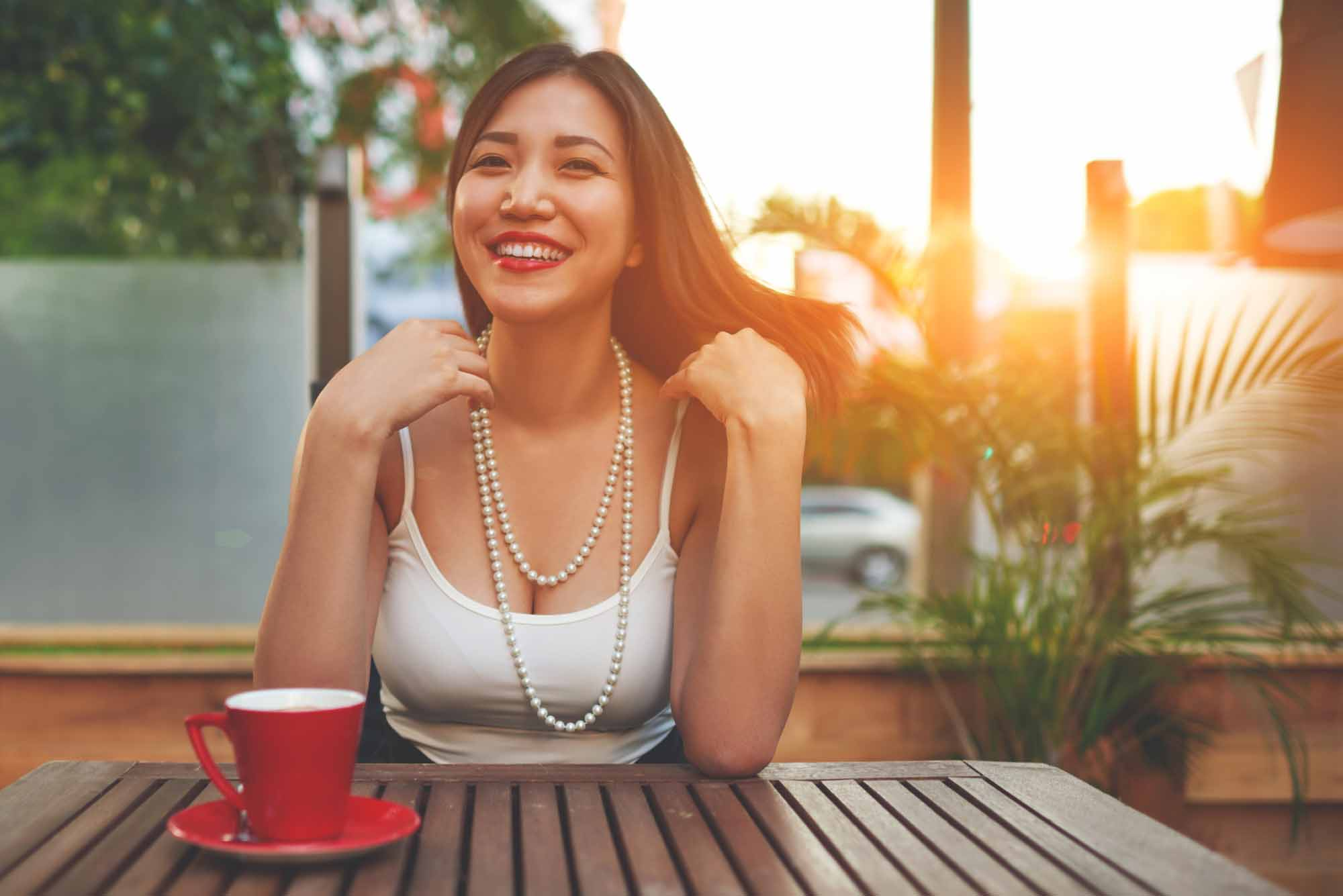 destress techniques girl smiling at table during sunset